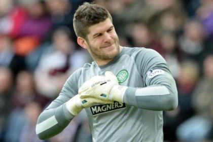 Fraser Forster smiles as he breaks the Scottish league shut-record held by Aberdeen's Bobby Clark