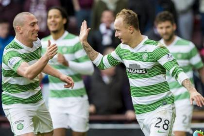 Leigh Griffiths got off the mark and celebrates his strike with skipper Scott Brown