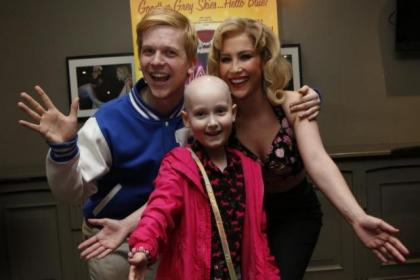IT was 'Happy Days' for Yorkhill patient Kiera MacDonald, above, when she met Scott Waugh and Heidi Range from the touring production of the hit show. Children's Hospice Scotland supporter Olivia Mooney, inset, also got in on the act, meeting Cheryl Baker. The show is on at the King's