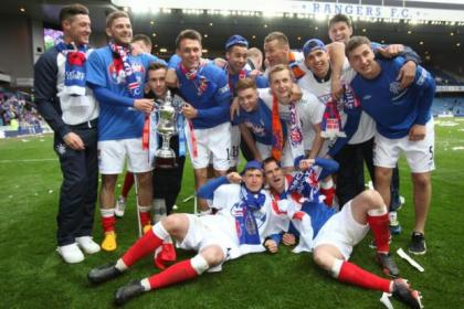 Rangers players celebrate winning the league last season