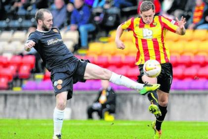 James Craigen and Motherwell's James McFadden battling for the ball in the game on December 29. Craigen is keen to get back in the Jags side