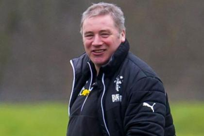 Ally McCoist smiled through the off-field row as Rangers trained at Murray Park on Thursday