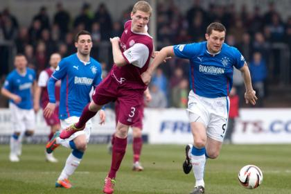 Rangers' Jon Daly and Arbroath's Colin Hamilton (left) battle for the ball