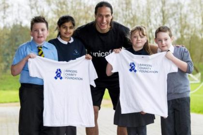 Bilel Mohsni with Ibrox Primary School pupils, from left, Jack Abercrombie, Karina Dhillon, Brook Wilson and Dylan O'Leary promote the Rangers Charity Foundation in partnership with Unicef which is bidding to fund up to one million vaccines by 2015