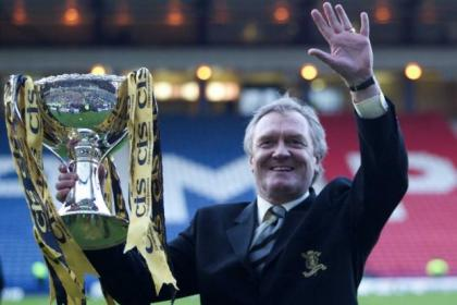 Livingston manager Davie Hay holds aloft the League Cup in 2004
