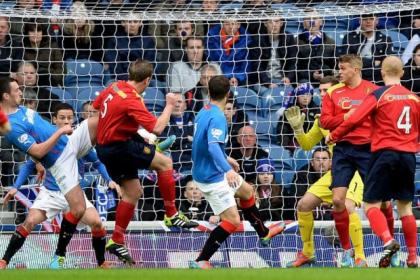 Ciaran Donnelly (far left) stuns Ibrox by firing his League Two Albion Rovers side into the lead against Rangers