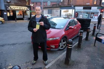 Jamie MacBrayne with the ticket he was issued with after parking in Partick Bridge Street