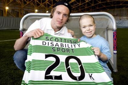 Celtic's Norwegian star Stefan Johansen joins young Jamie Henderson (13) from Milton  to help announce a brand new partnership between  the club  and Scottish Disability Sport