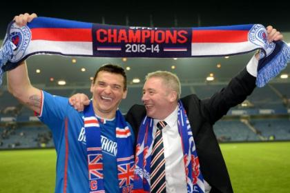 Lee McCulloch and Ally McCoist salute the Rangers fans after securing League One title