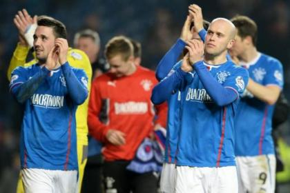 Rangers' Nicky Clark, Nicky Law and their team-mates applaud the fans at the end of game after clinching the League One title after a 3-0 victory over Airdrie at Ibrox on Wednesday night