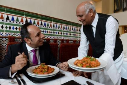 Asif Ali, with waiter Mohamed Nazir, samples Shish Mahal's chicken tikka masala.Picture: Nick Ponty