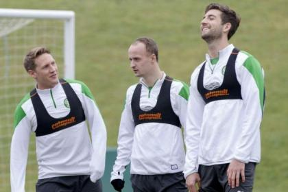 Celtic stars Kris Commons, Leigh Griffiths and Charlie Mulgrew limber up for their trip to Rugby Park this evening