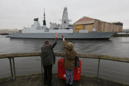 People watch on as the destroyer sailed up the Clyde