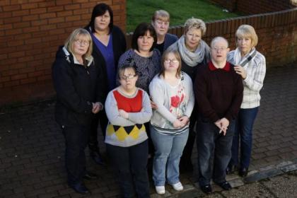 Families left struggling after the closure of a day centre include, left to right, back row: Helen McCourt, Kim Kenny, Grace Harrison, Mary McArthur, Terri McCue, George Crone, Maureen Crone.  Front row: Cheryl McArthur, Laura McCourt. Picture: Colin Templeton