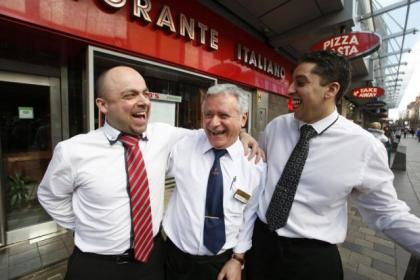 Restaurant co-owner Tony Crolla, above left, at the city landmark with waiters Giuseppe Dimilta and Michael Valigy. Inset, a farewell kiss for Tony from long-time regular Dino's customer Anne Walker, aged 83. Picture: Martin Shields