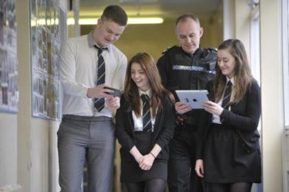 Aaron McMadh, 16, Olivia White, 16, Inspector Alistair Anderson and Nicola Conlon, 16, help launch the Stay Save Online campaign at Clyde Valley High School in Wishaw              Picture: Jamie Simpson