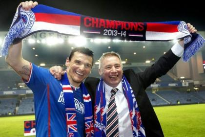 Rangers captain Lee McCulloch and manager Ally McCoist celebrate after becoming Scottish League One champions