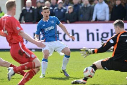 Fraser Aird slots the ball past Brechin City keeper Graeme Smith to open the scoring for Rangers