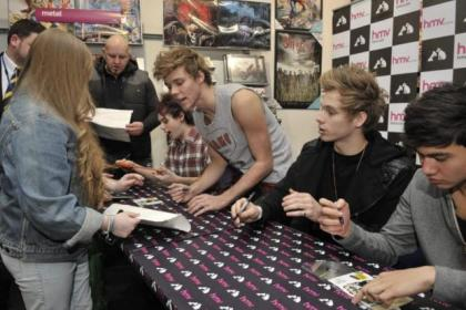 5 Seconds of Summer delight fans who queued for hours to meet their idols