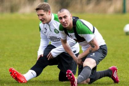 Celtic captain Scott Brown and Kris Commons limber up for tonight's potential title-clincher at Firhill