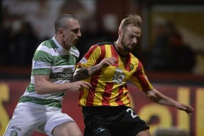 Celtic skipper Scott Brown closes down Partick Thistle's forward Kallum Higginbotham. Picture: Jamie Simpson