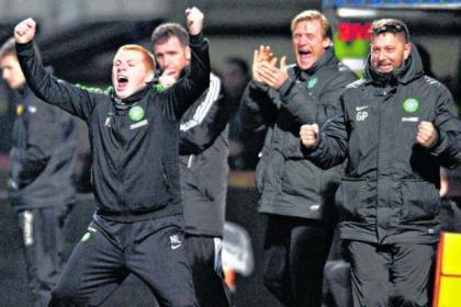 Celtic manager Neil Lennon punches the air in delight on a night he emulated Martin O'Neill and Gordon Strachan
