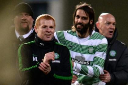 Georgios Samaras celebrates with manager Neil Lennon after clinching the league title on Wednesday night at Firhill