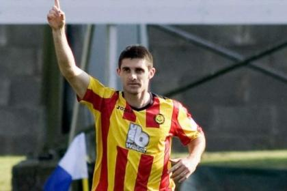 Kris Doolan celebrates scoring on Thistle's last Perth trip - he'll want more this time