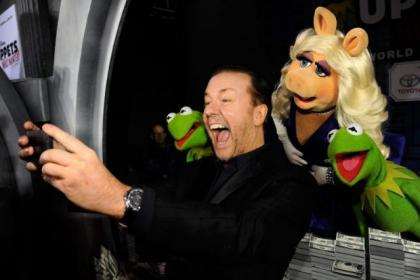 Ricky Gervais takes a 'selfie' with Muppets Most Wanted stars Constantine, Miss Piggy and Kermit the Frog at the premiere of the film in Los Angeles