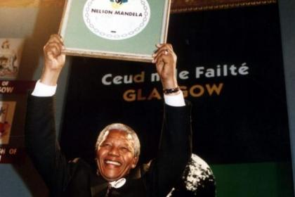Nelson Mandela collects the Freedom of in Glasgow in 1993. Brian Stilling, inset, a friend of the anti-apartheid hero, will chair a celebration of his life to kick off the Aye Write! book festival at the Mitchell Library on Friday
