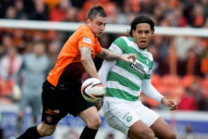 Dundee United's Paul Paton (left) and Celtic Virgil Van Dijk (right) during the Scottish Premiership match