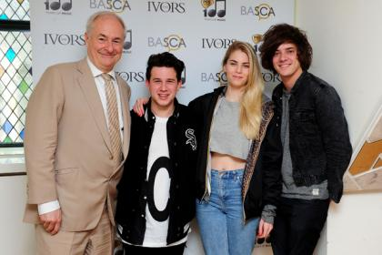 Paul Gambaccini with Dan Rothman, Hannah Reid and Dominic 'Dot' Major of London Grammar at the nominations announcement for this years Ivor Novello awards, at the Ivy Club in London.