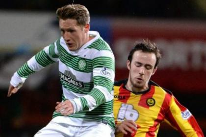 Partick Thistle ace Stuart Bannigan slows down Celtic's Kris Commons in the only  game in which the Firhill  midfielder feels his side have met their match in recent weeks of Premiership encounters