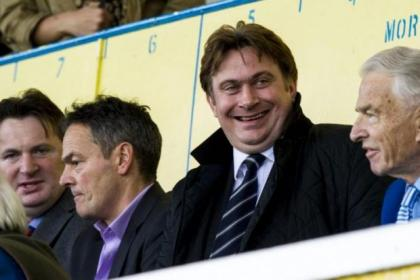 Douglas Rae (right) with his son Crawford (second left) and James and Sandy Easdale in the directors box at Cappielow