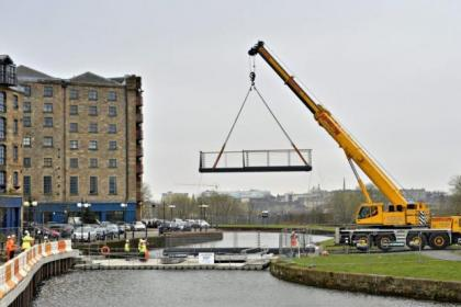A new footbridge was lifted into place over the canal at Spiers Wharf