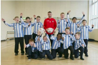 Partick Thistle's Sean Welsh with St Joseph's Primary School football team as part of a Glasgow Cup promotion. Picture: Phil Rider