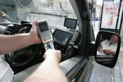 It's a fares revolution as  Glasgow taxis start using the chip and PIN machines Picture:  Phil Rider
