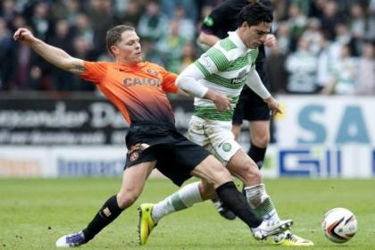 Dundee United's John Rankin tackles Beram Kayal during Saturday's 2-0 victory for Celtic