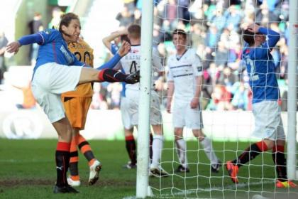 Bilel Mohsni boots the goal post in frustration after passing up an opportunity to net for Rangers