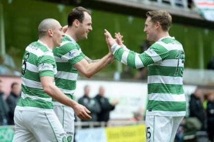 Scott Brown and fellow Celtic goalscorer Kris Commons celebrate with Anthony Stokes, centre, after he netted against Dundee United