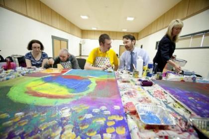Peter Scott, chief executive officer of Enable Scotland, talks to Scott Brown and others taking part in an Inspire Arts project at Townhead Village Hall, Glasgow. Pictures: Mark Gibson