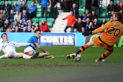 Lee Wallace sees his shot saved by Raith Rovers keeper Lee Robinson before going off injured later in the game