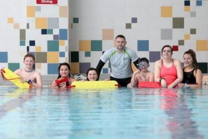 Trainer Alan O'Neill with student lifeguards Kieran McGlory (12), Katie Templeton (12), Chloe Todd (10), Dean Butchrat (10), Marissa McLaren (15) and Naomi Todd (13) at lifeguard lessons at Springburn Glasgow Club. Picture: Mark Mainz