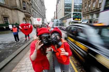 Friends of the Earth campaigners protest against air pollution in Hope Street - the city's most-polluted area