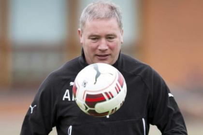 Rangers manager Ally McCoist shows he still has his touch during a training session at Murray Park yesterday