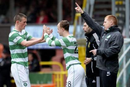 Celtic colt Liam Henderson, left, comes off for Leigh Griffiths as Neil Lennon watches on from touchline