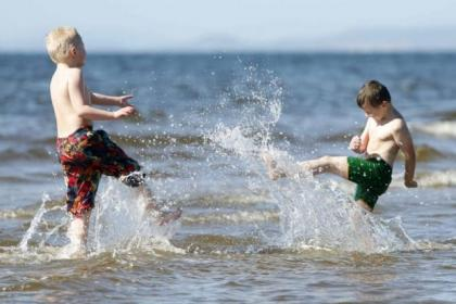 Cody Simpson and Jack Foley make a big splash as they have fun during a day out at Ayr beach