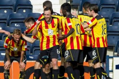 Kallum Higginbotham, left, is congratulated by his team-mates after scoring against Killie