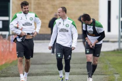Charlie Mulgrew, Leigh Griffiths and Scott Brown share a joke on their way to a training session at Lennoxtown yesterday