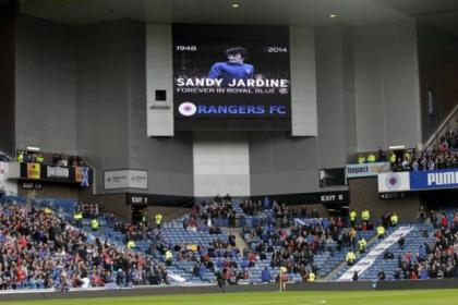 Sandy Jardine, who died last week aged 65, was remembered by the Rangers family before the 3-0 victory over Stranraer